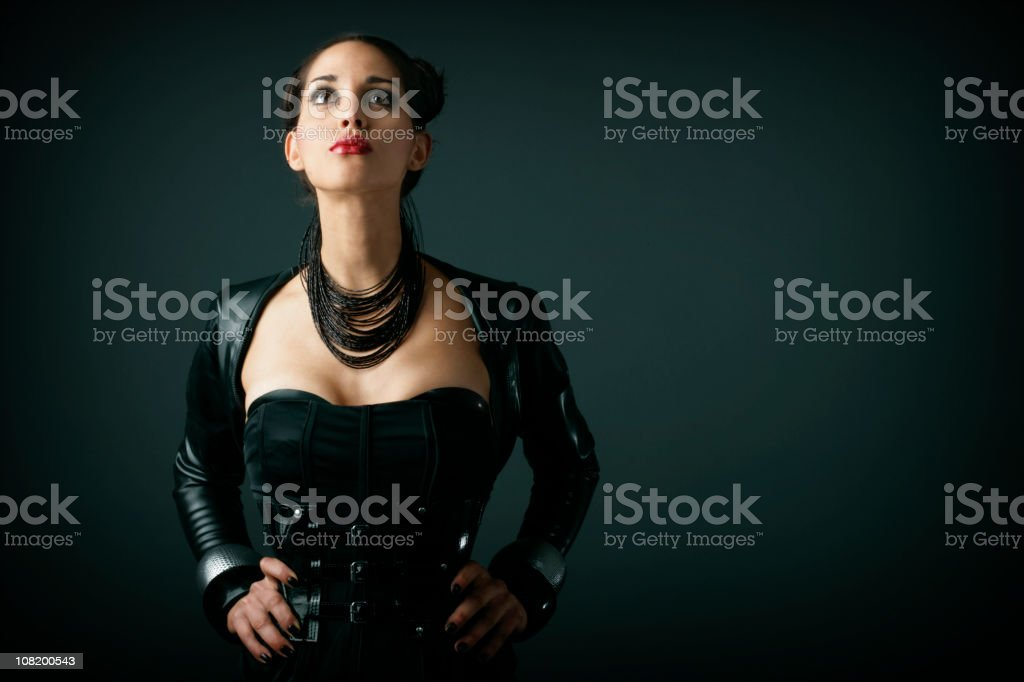 Potrait of Young Woman Posing and Wearing Latex Costume royalty-free stock photo
