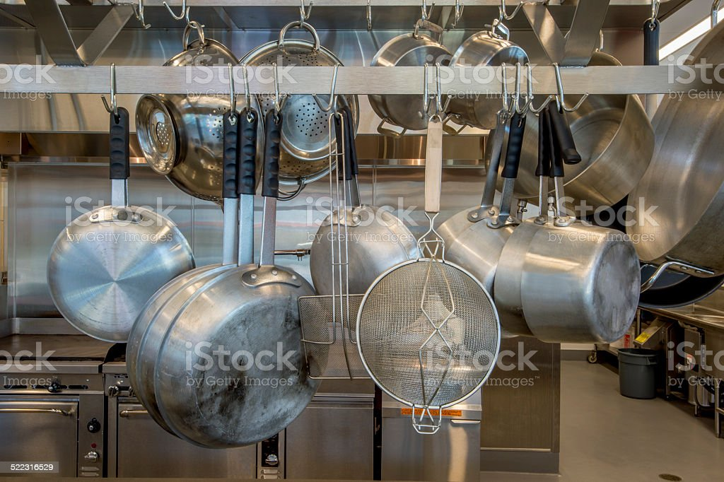 Pots and Pans on Rack stock photo