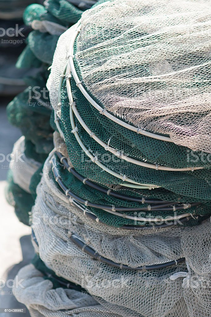 Pots in nylon mesh piled on the pier stock photo
