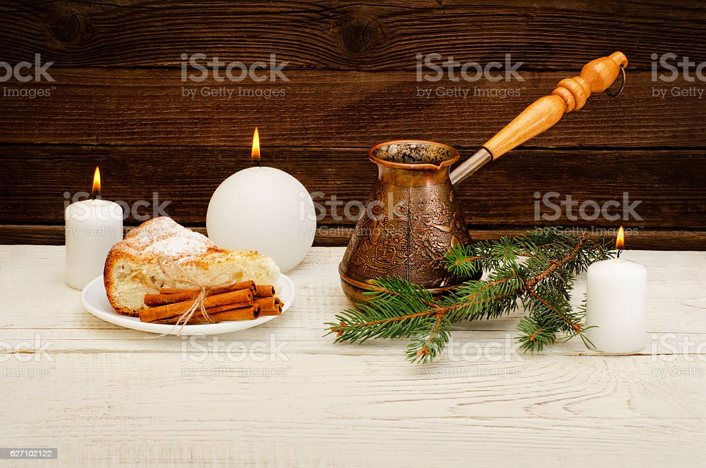 Pots of coffee, fir twig, apple pie, wooden background stock photo
