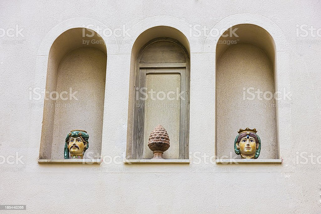 Pots on a facade, in Taormina, Italy royalty-free stock photo