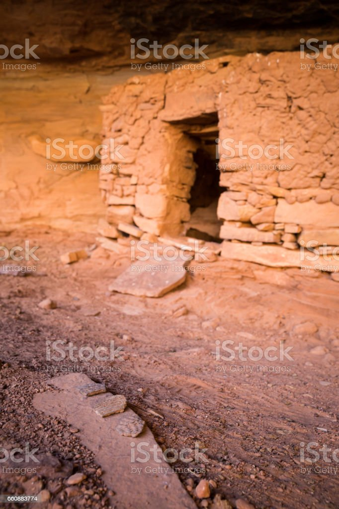 Potsherds in front of dwelling entrance stock photo