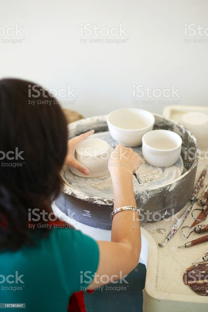Potter at the wheel royalty-free stock photo