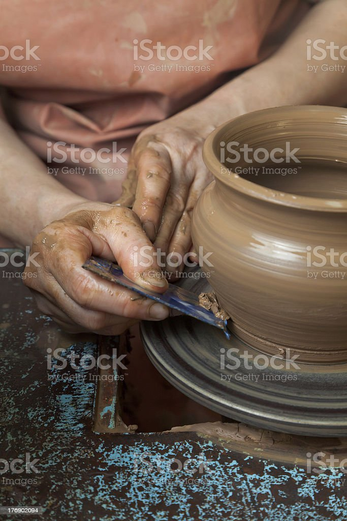 Potter creates  pitcher on a pottery wheel royalty-free stock photo