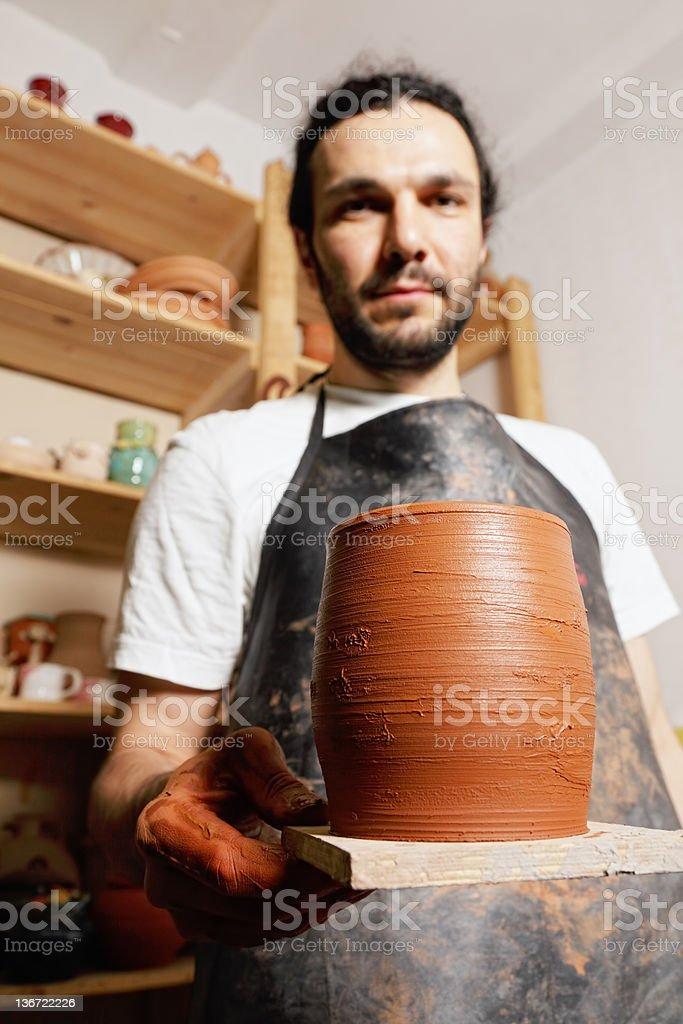 Potter demonstrating jug royalty-free stock photo