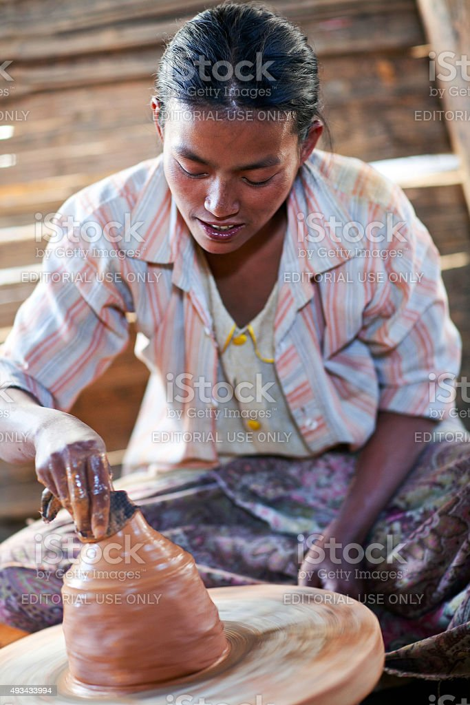 Potter girl, Myanmar stock photo