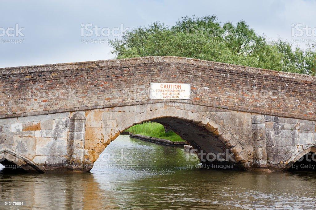 Potter Heigham low bridge on river Thurne Norfolk Broads England stock photo