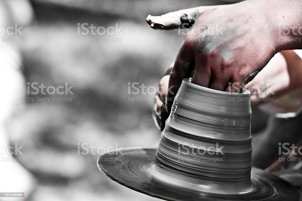 A potter is molding something out of clay stock photo