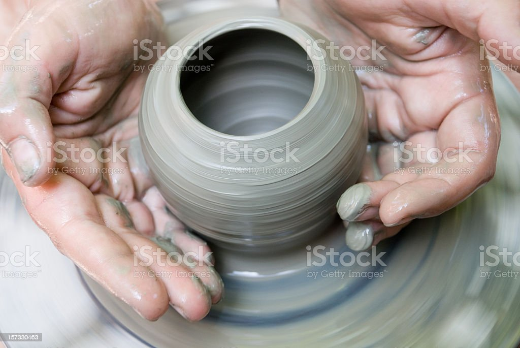 potter makes a jug out of clay stock photo