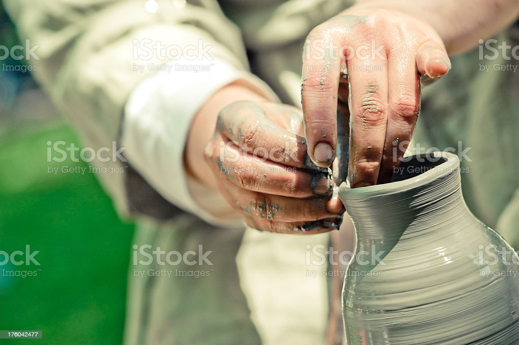 potter makes a jug out of clay royalty-free stock photo