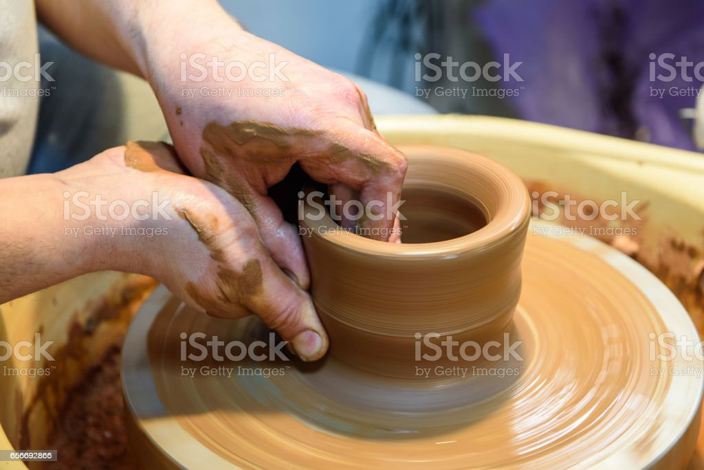 potter makes a pot of clay. stock photo