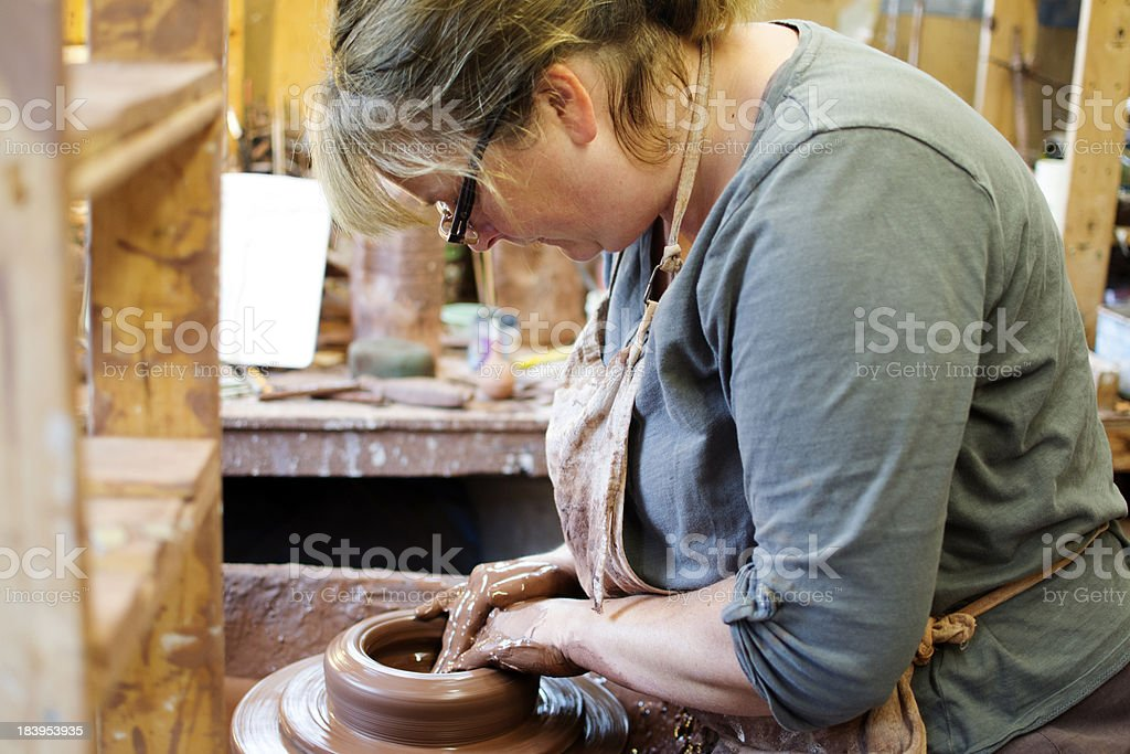 Potter making a jug stock photo