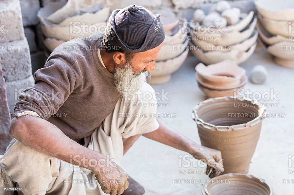 Potter making clay pot in Rajasthan, India stock photo