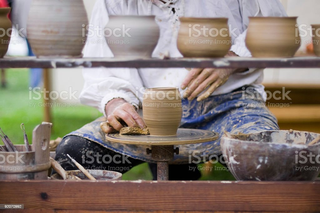 Potter making handcrafted pottery on the wheel stock photo