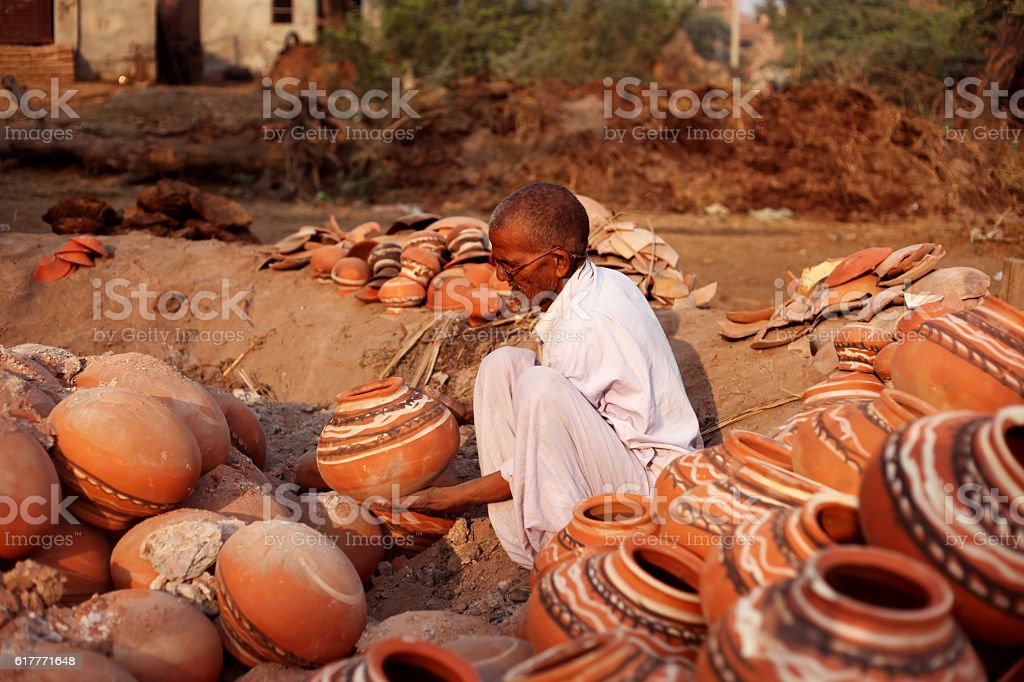 Potter remove the fired clay pots stock photo