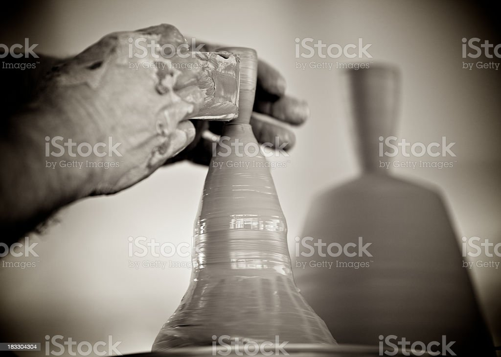 Potter shaping clay object on wheel - black and white royalty-free stock photo
