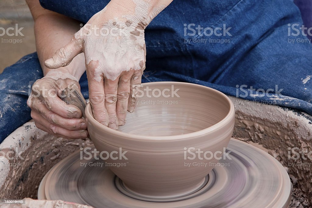 Potter Smoothing a Clay Bowl stock photo