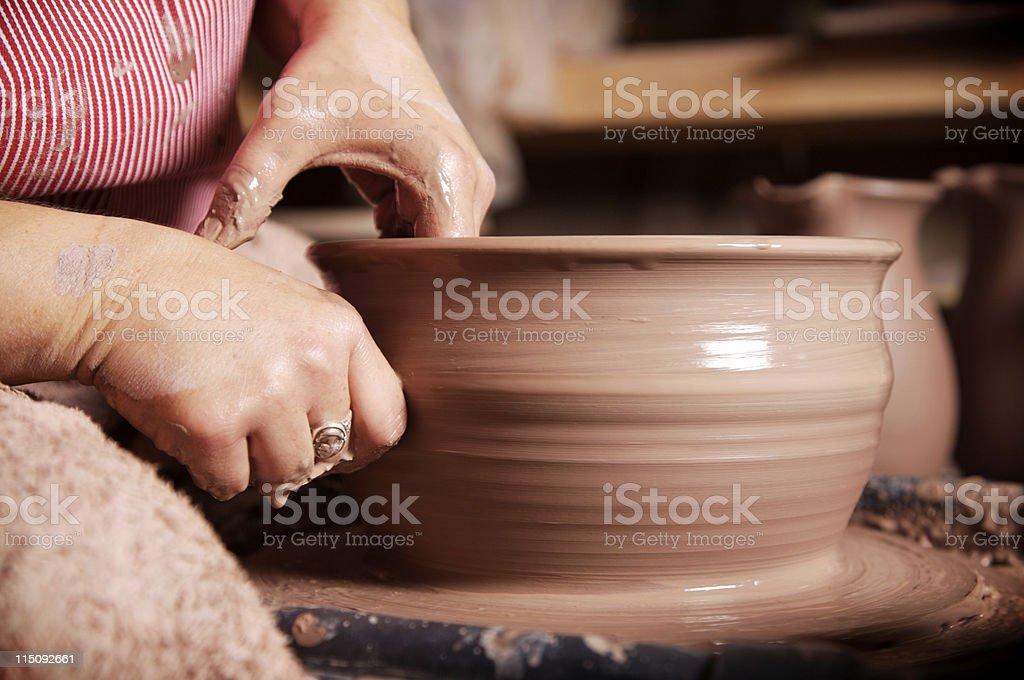 potter wheel clay vessel - creation stock photo