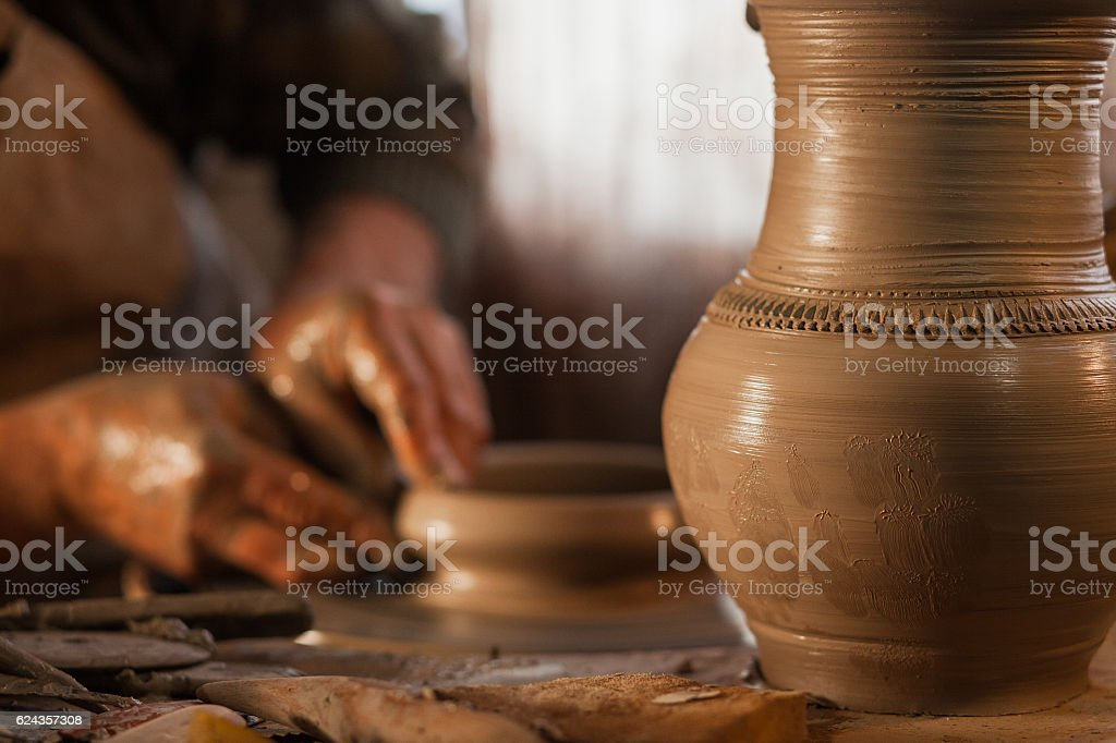 Potter working a piece of clay stock photo