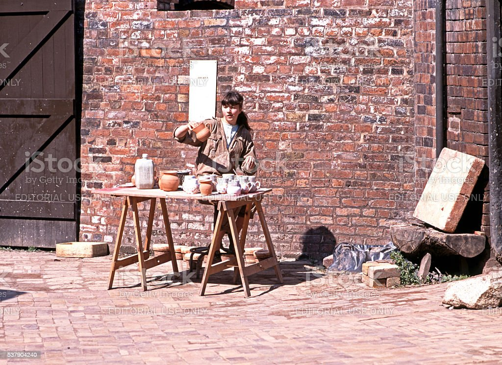 Potter working at the Coalport China Museum. stock photo