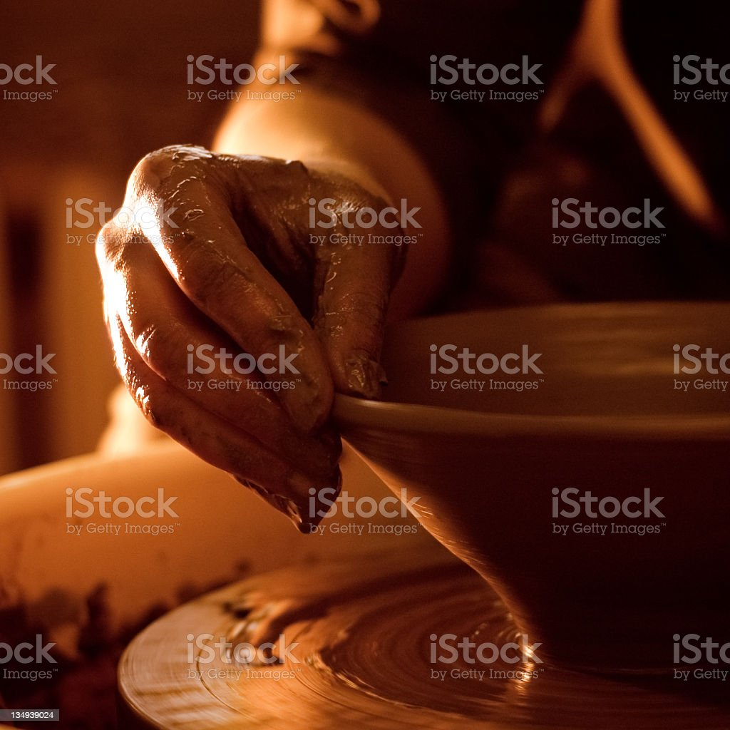 Potters hand stock photo