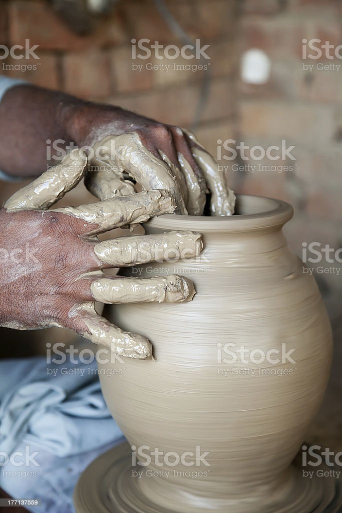 potter's hands giving shape to terracotta vase royalty-free stock photo