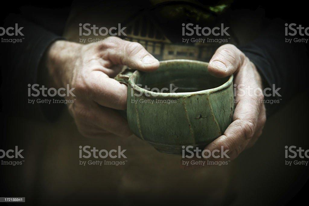 potter's hands hold handmade pottery mug stock photo