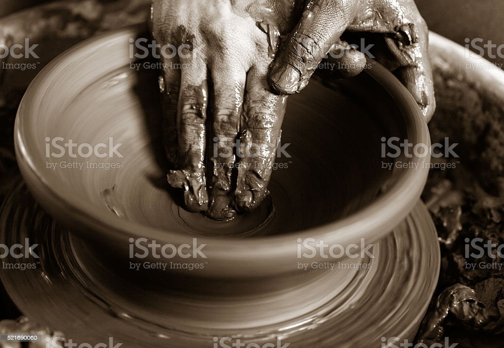 potter's hands with the product on a potter's wheel stock photo