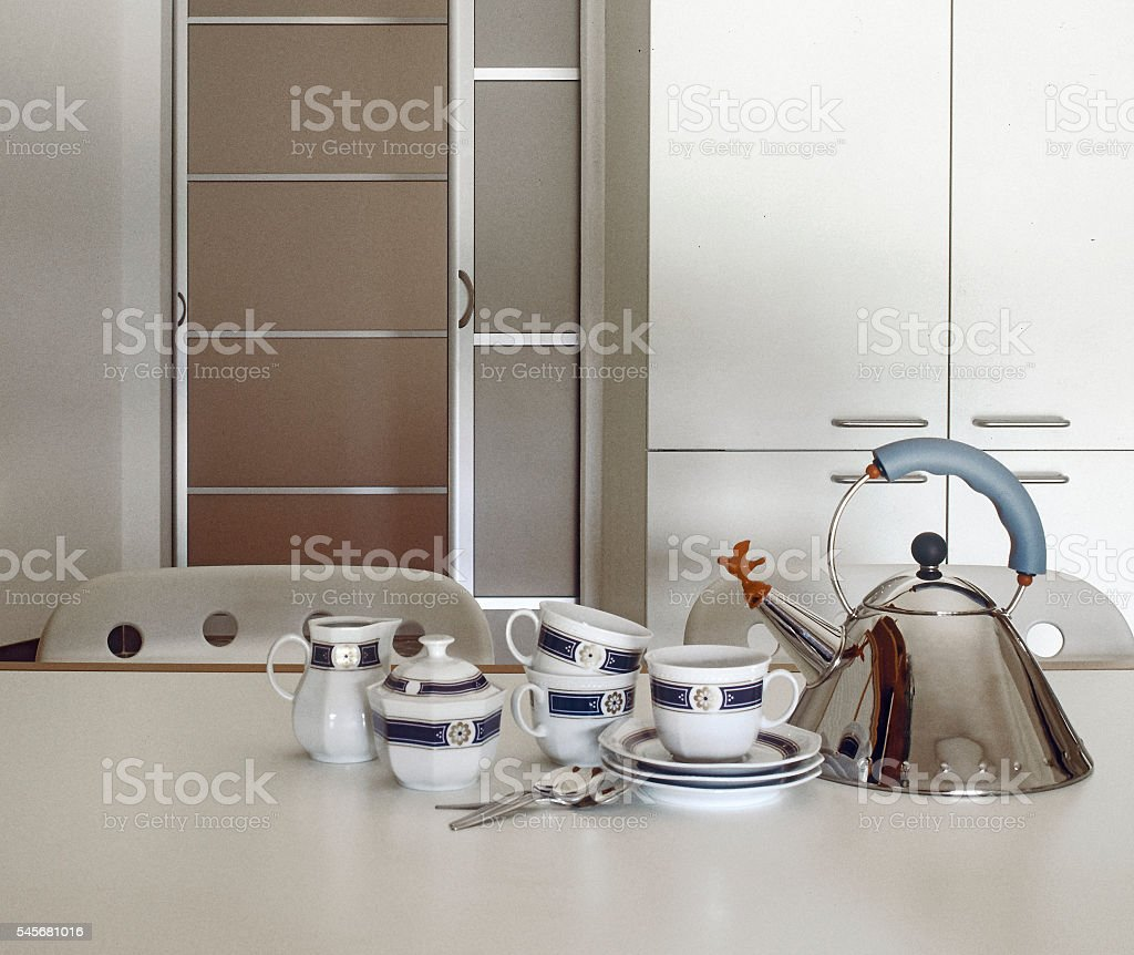 pottery and kettle on the table stock photo