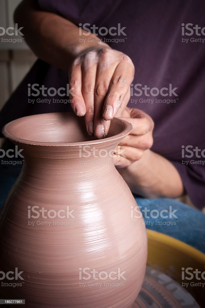 Pottery hands making a vase and smoothing it out stock photo