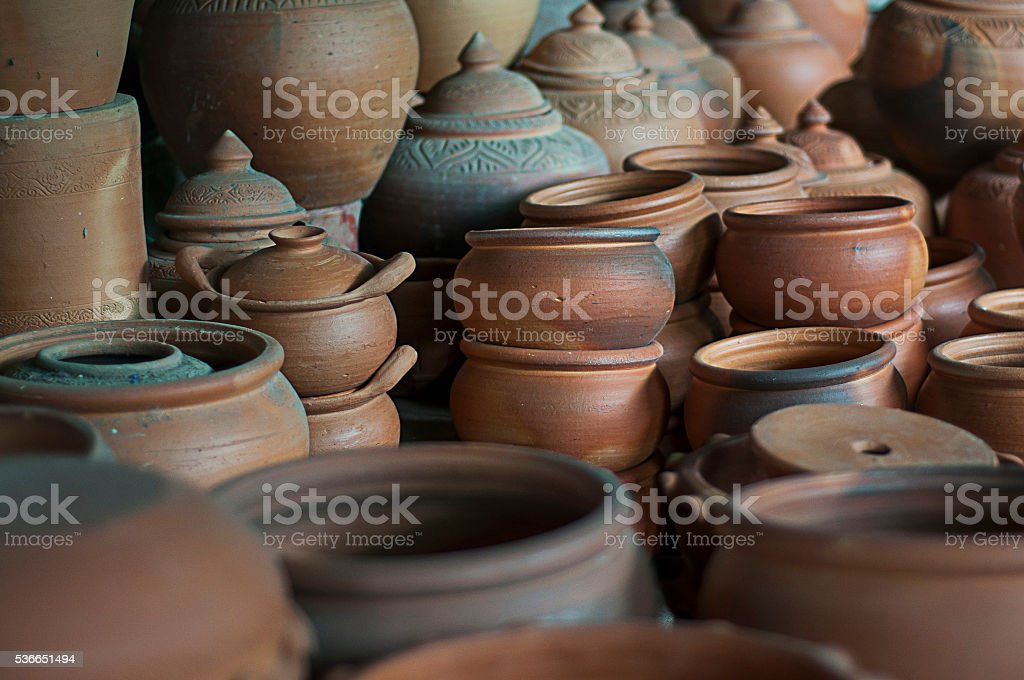 Pottery vessel placed into the furnace before airing . stock photo