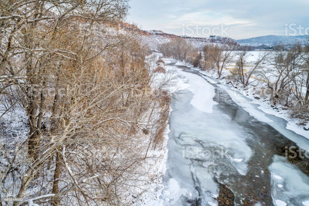 Poudre River above Fort Collins in winter scenery stock photo
