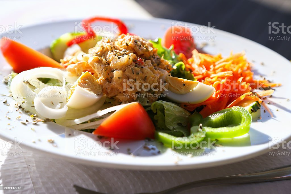 poultry meat in sesame with cheese and vegetables stock photo