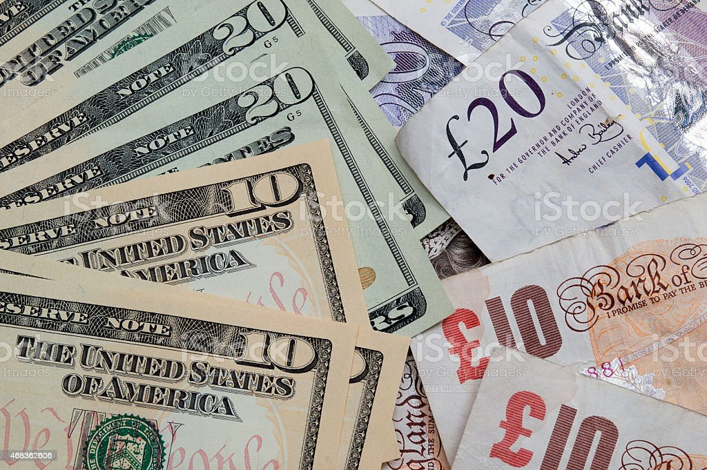UK Pound and United States Ten and Twenty Dollar bills. stock photo