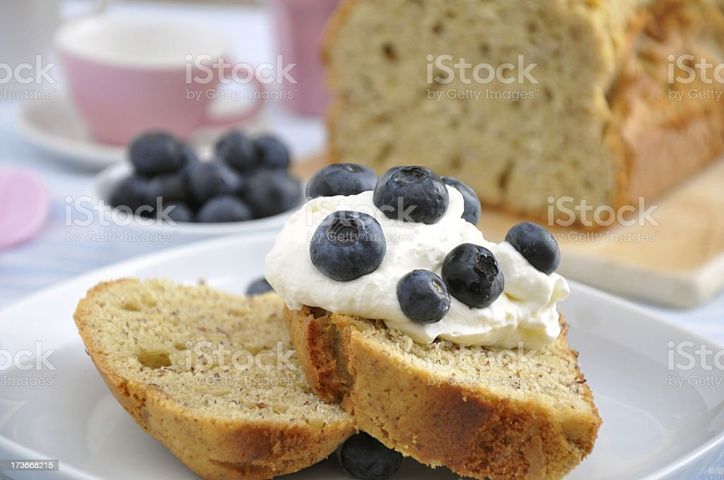 Pound Cake with cream and blueberries royalty-free stock photo