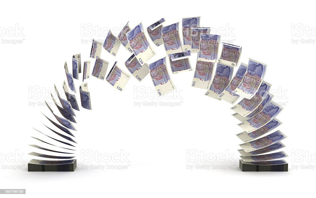 A pound foreign currency flying from one pile to the other  stock photo