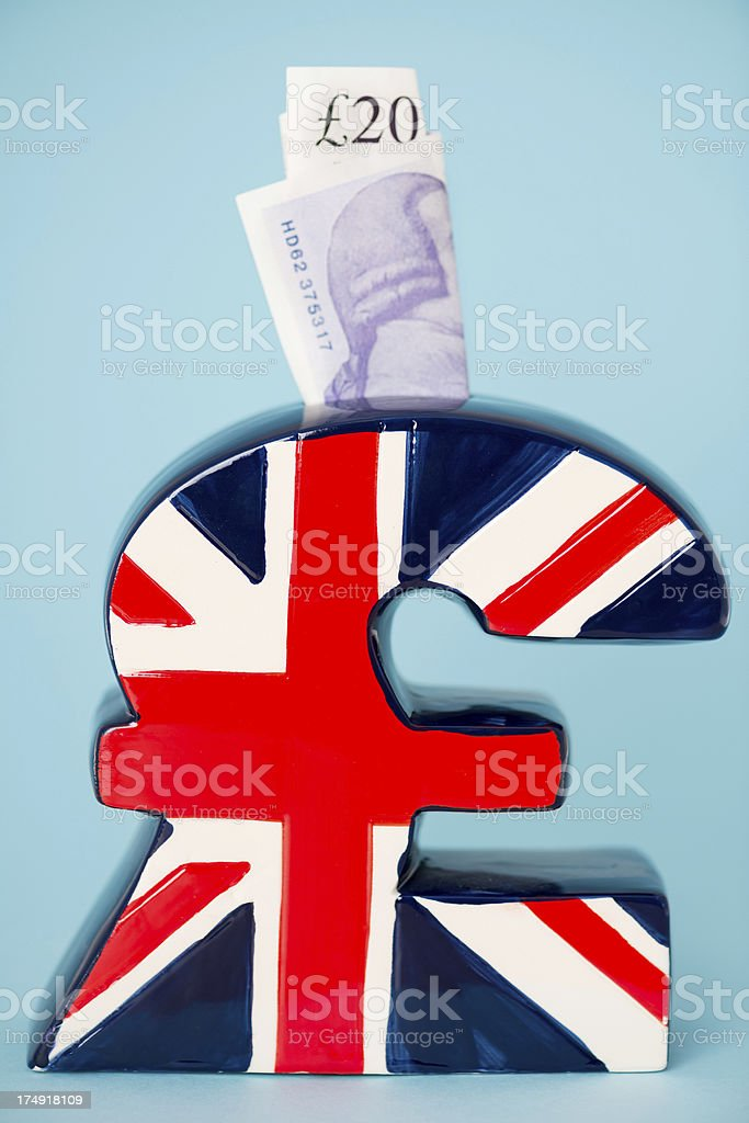UK pound symbol piggy bank royalty-free stock photo