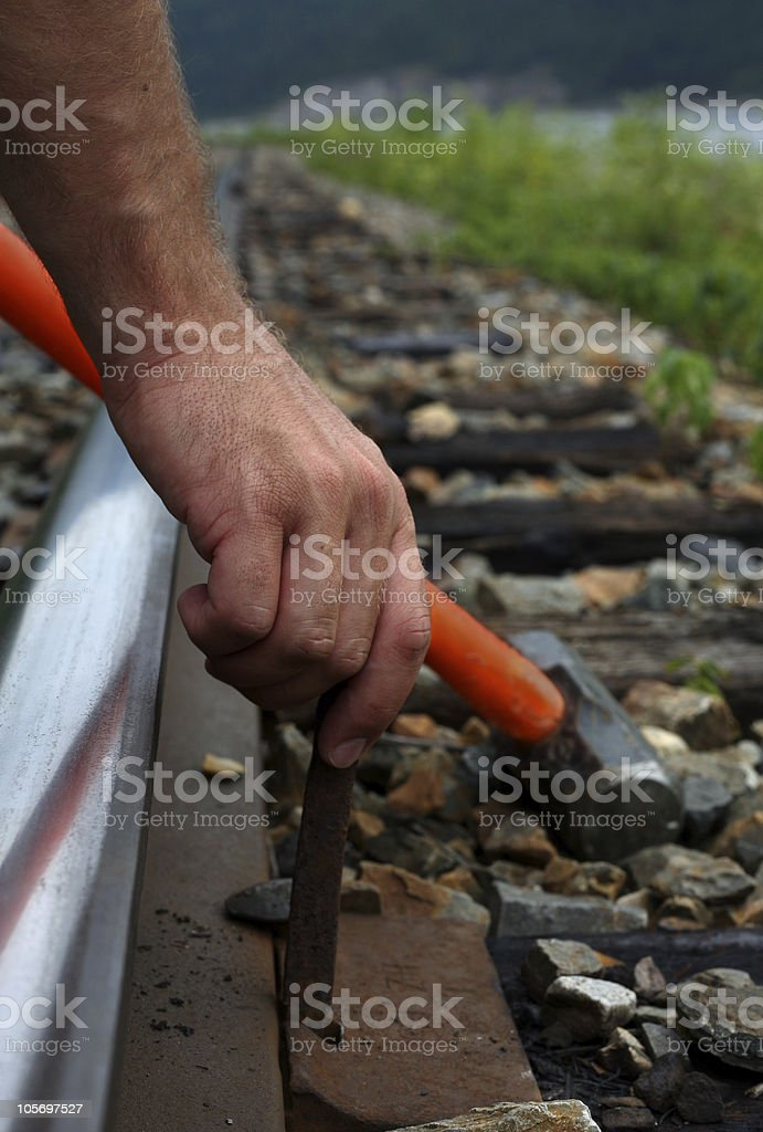 Pounding the last spike royalty-free stock photo