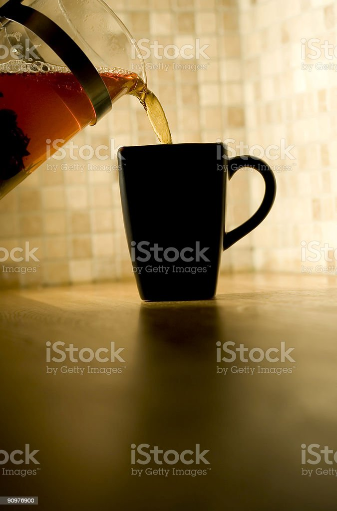 Pour Tea into cup royalty-free stock photo