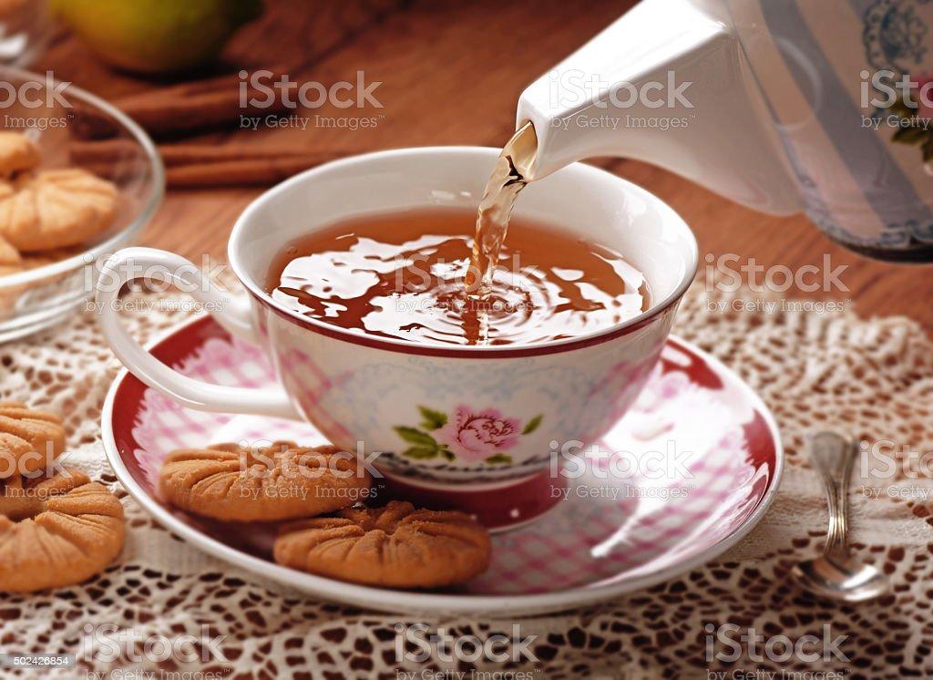 pour the tea stock photo