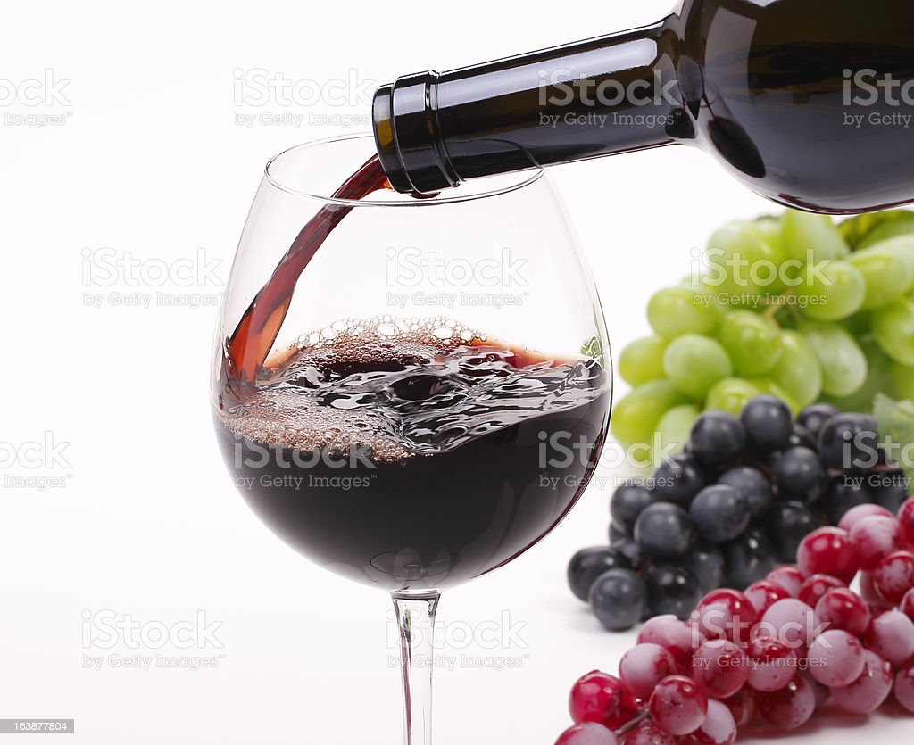 Pour the wine into a glass royalty-free stock photo