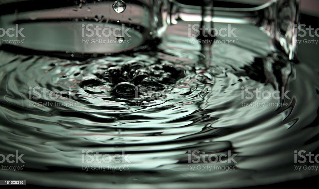 Pour water into the basin and splash beautiful shape. royalty-free stock photo