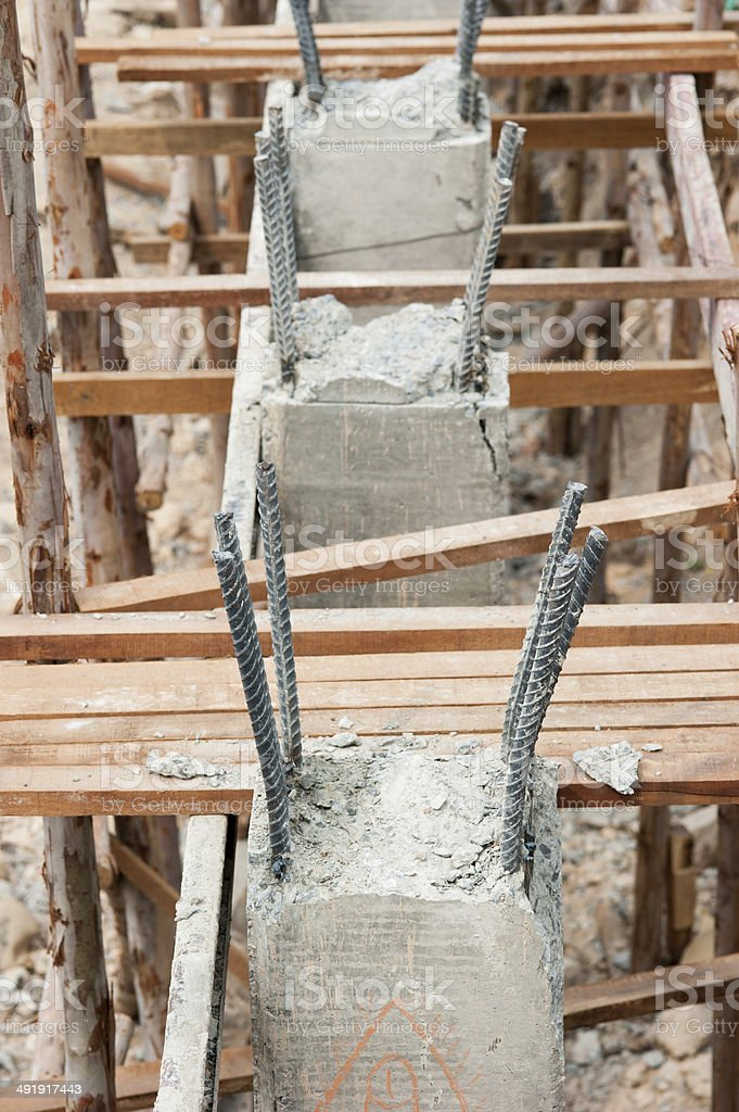 Poured cement with steel poles for construction stock photo