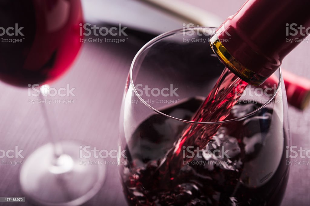 Poured red wine stock photo