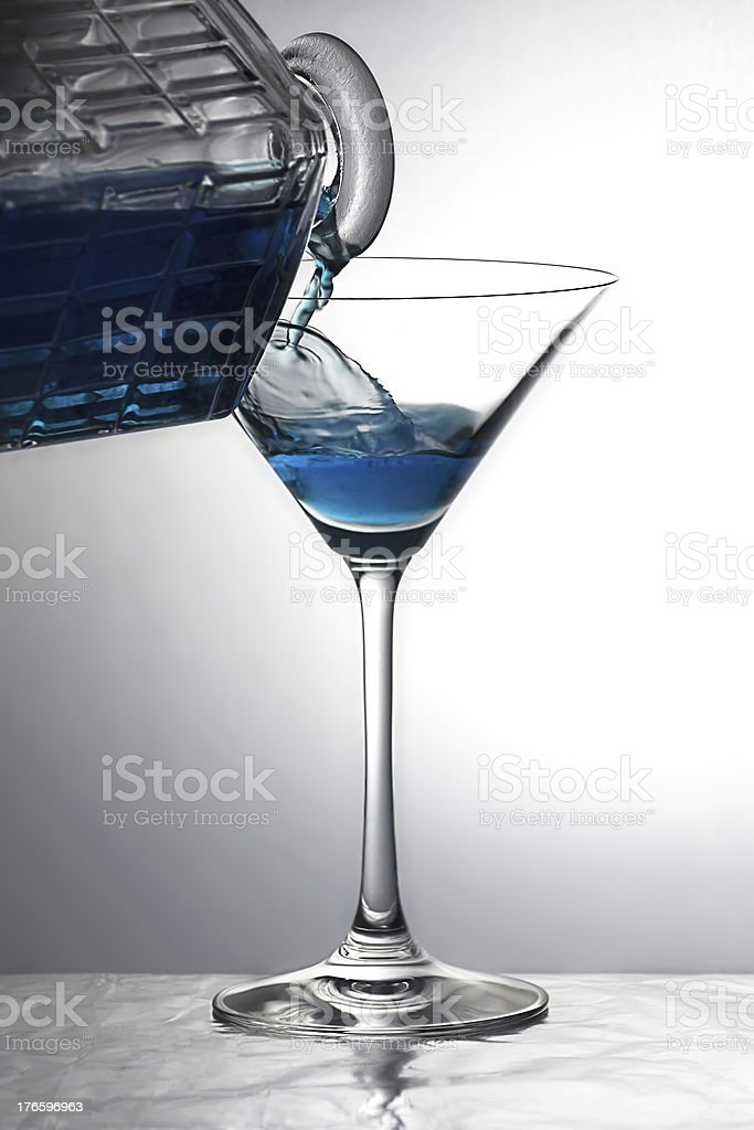 Pouring a blue drink royalty-free stock photo