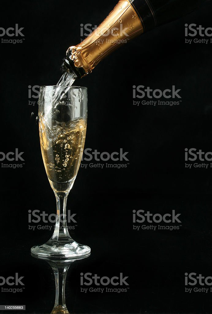 Pouring a champagne flute royalty-free stock photo