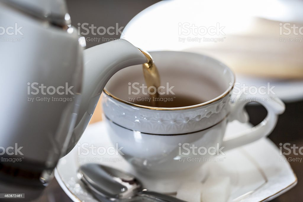 Pouring a Cup of English Tea royalty-free stock photo