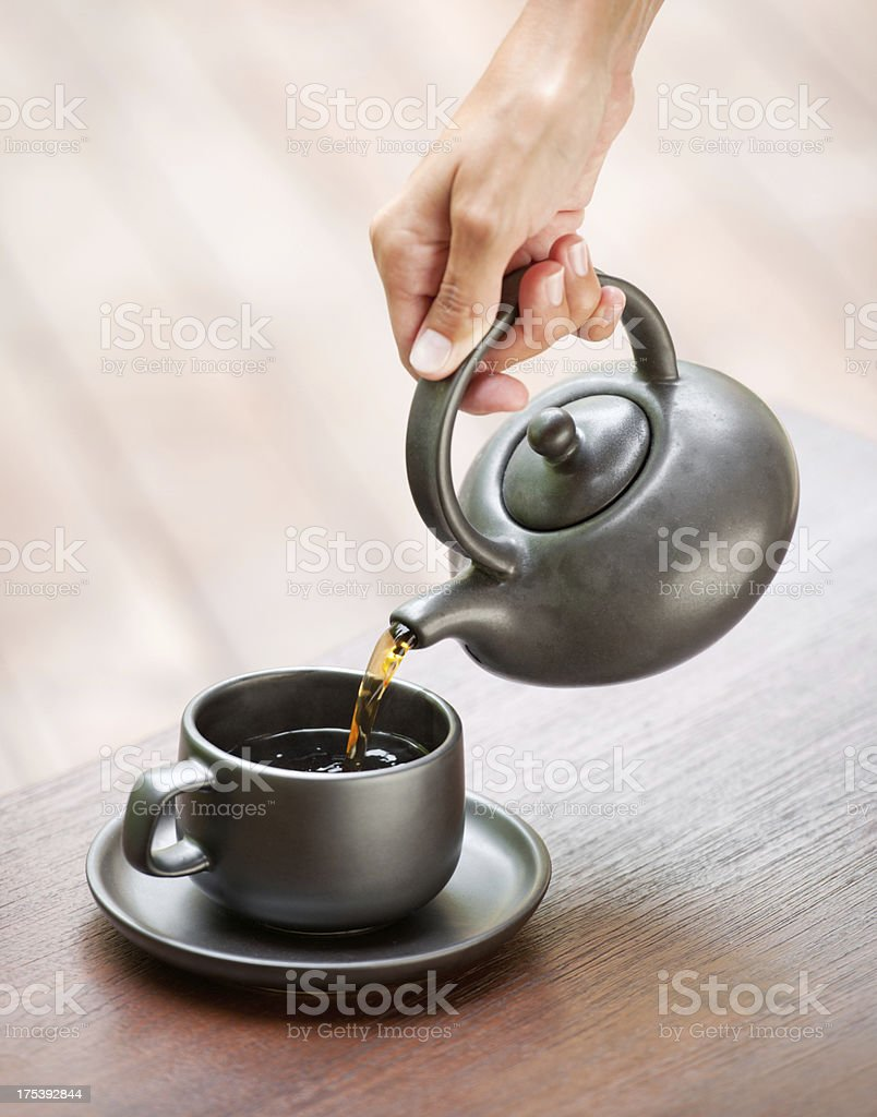 Pouring a Cup of Tea (XXXL) royalty-free stock photo