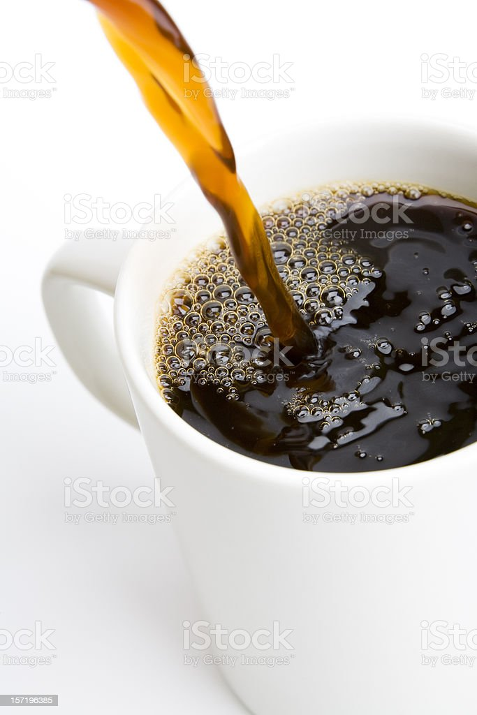 Pouring a Fresh Cup of Brewed Coffee (Isolated) royalty-free stock photo
