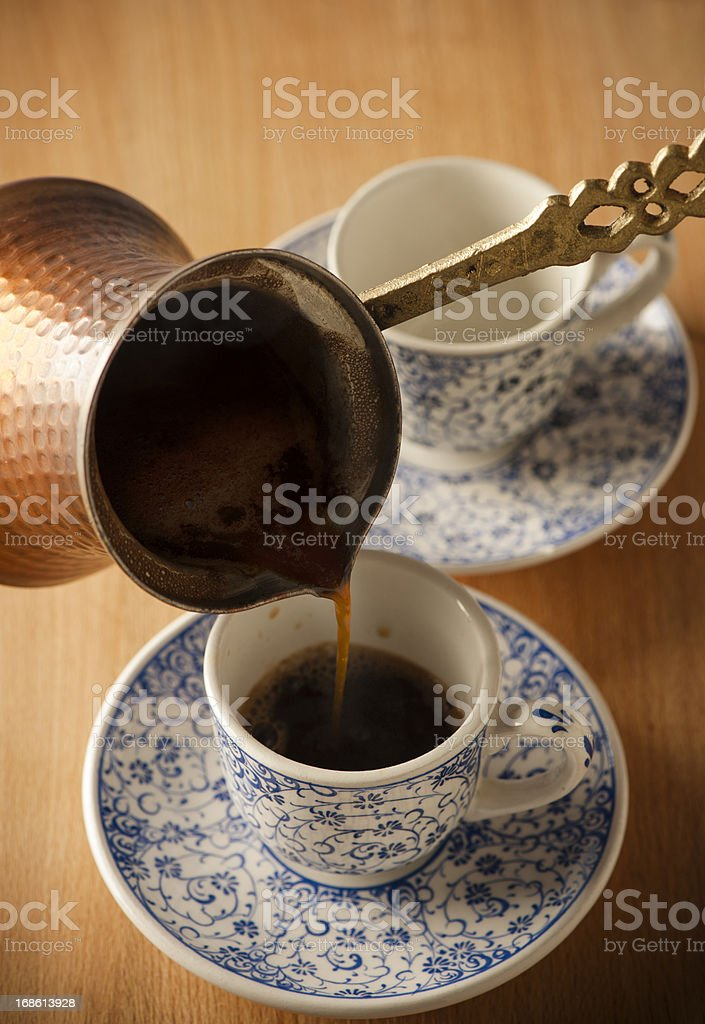 Pouring a Fresh Cup of Brewed Coffee royalty-free stock photo